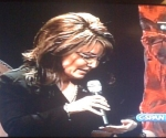 Palin Glancing at Her Hand Before Answering Question